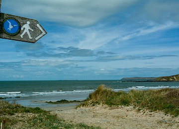 Anglesey Coastal Path sign at Porth Tywyn Mawr beach