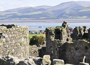 Beaumaris castle overlooks the Menai Strait and mountains of Snowdonia in North Wales