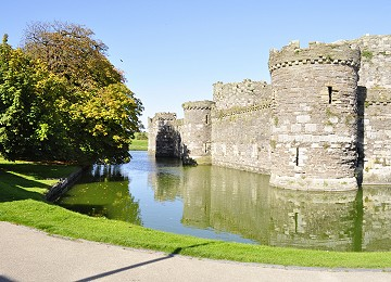 The walls and moat at Beaumaris Castle in Autumn