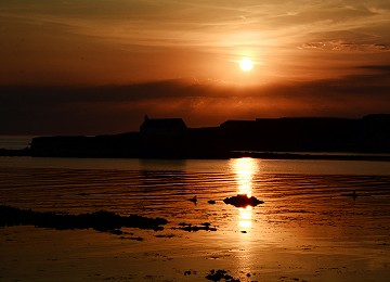 Big sunset over st cwyfan's