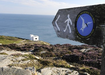 Anglesey Coastal Path sign and Elins tower at South Stack
