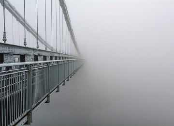 Disappearing Menai Suspension Bridge in the fog