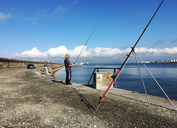 Fishing on the Holyhead breakwater on Anglesey