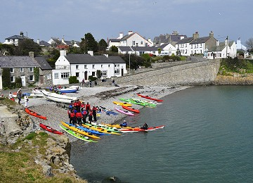Launching Kayaks from Moelfre beach on Anglesey