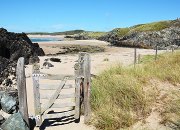 Llanddwyn beach with rugged gate