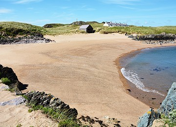 Llanddwyn island beach and pilot cottages in summer