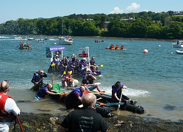 The annual raft race from Y Felinheli to Menai bridge raises lots of money for local charities