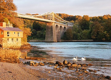 The Menai Suspension bridge in the evening sun at low tide