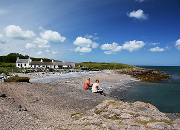 Visitors enjoy the view at Moelfre North beach