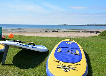 Paddle boards at the ready Rhosneigr beach