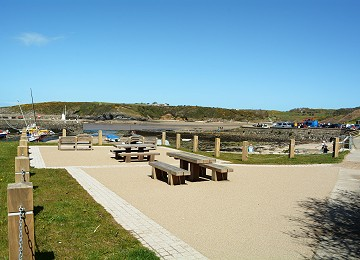 Picnic tables overlooking the cemaes bay beach