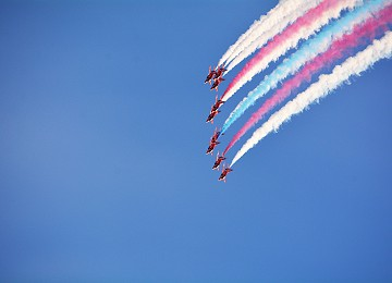 Red Arrows with smoke on above RAF Valley